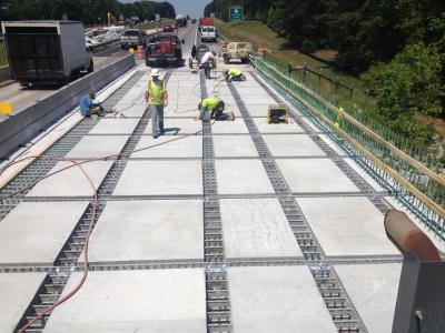 Precast deck panels in place