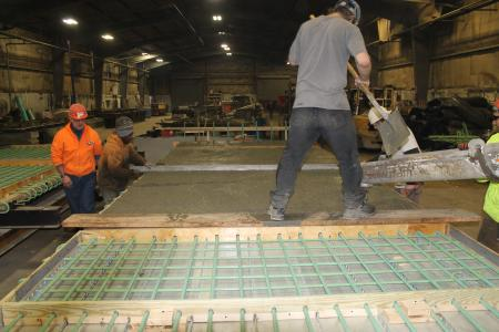 Panels being precast under controlled conditions