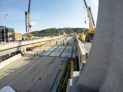 The last precast panel is set during a weekend closure